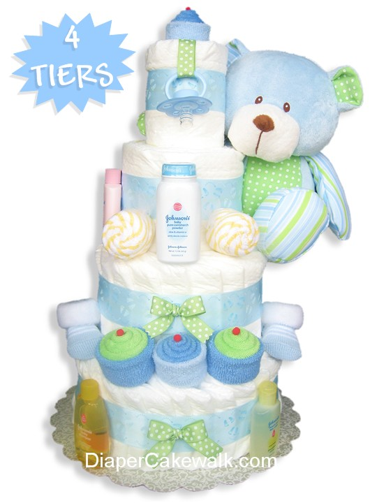 Blue and green diaper cake decorated with cupcakes and candies